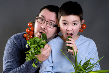 Dad and son with vegetables