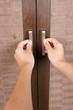 female hands opening closet door