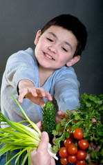 Portrait of the boy with vegetables