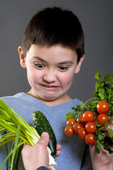 The boy does not like the vegetables