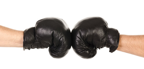 Two male hands together in black boxing gloves isolated