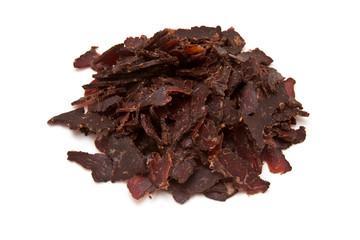 Sliced biltong (dried beef) on a white background.