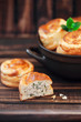 Mini pies with chicken and green onions, selective focus