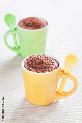 Dessert of cream cheese, yogurt and chocolate in coffee cup