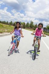 Happy African American Girls Riding Bikes