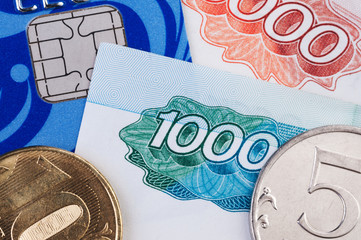 Credit card, banknotes and coins