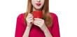 Red-haired girl with cup.