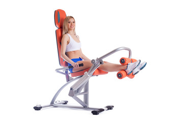Blonde young woman on orange exerciser
