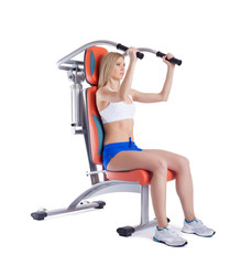 Athletic young woman on isodynamic exerciser
