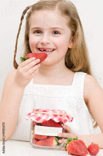 Strawberry time - lovely girl eating strawberries
