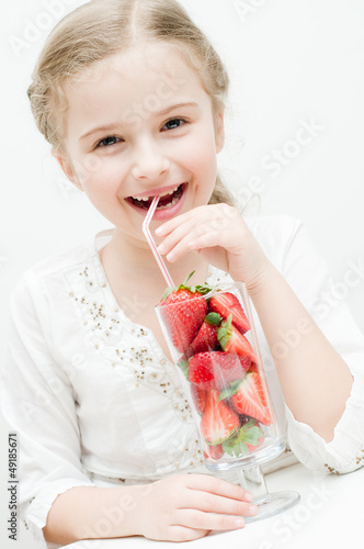 Strawberry time - lovely girl with fresh strawberries