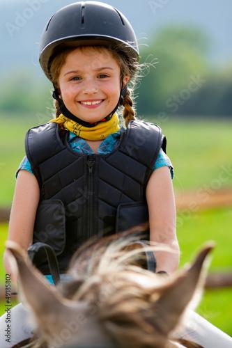 Papiers peints Equestre Horse riding - portrait of lovely equestrian on a horse