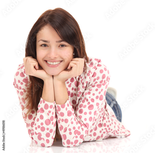 Portrait of a smiling young woman lying on the floor
