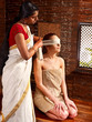 Woman having ayurveda spa treatment.