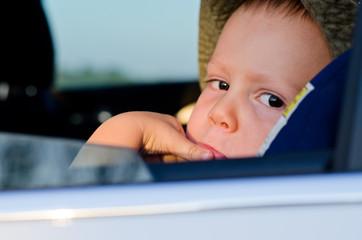 Bored little boy in a car
