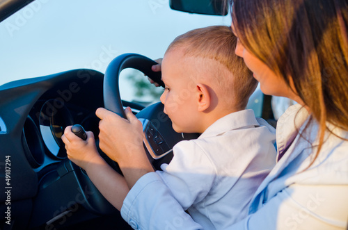 Small boy learning to drive