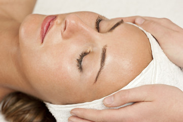 a woman relaxes during a spa treatment