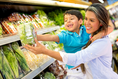 Woman at the supermarket with her son