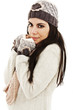 Cute woman wrapped up warm in winter clothes