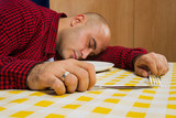 Man sleeping at the dinner table