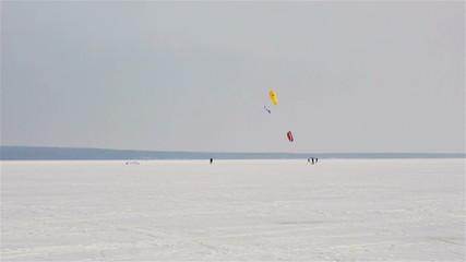 Snow-kiting on a frozen lake