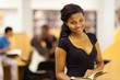 cute female african american college student in library