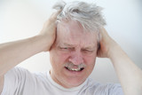 man with severe headache pain