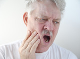 man with pain in cheek