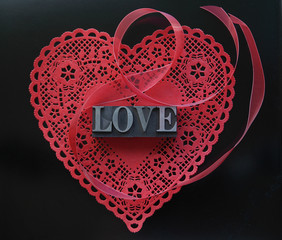 red heart doily with love on black
