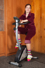 Woman exercise on spinning bike