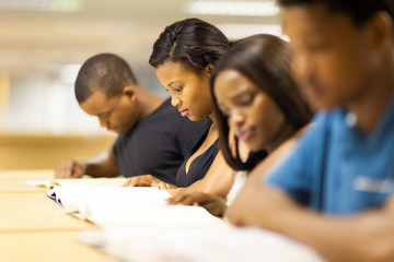 group of african college students reading in library
