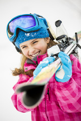Skiing, winter sports - portrait of lovely young skier