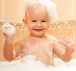 happy joyful kid in a bath