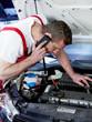 Car mechanic calls a customer before fixing the car