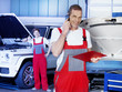 Car mechanic calls a customer to discuss repair costs