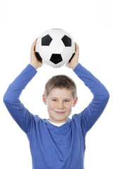 boy holding a football ball
