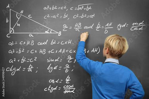 Schoolboy at the Blackboard with Formulas