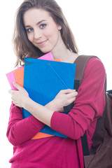 Young student holding books, isolated on white