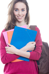 Young female student holding books, isolated on white