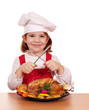 little girl cook with roasted chicken studio shot