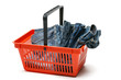Red shopping basket full of new jeans, over white background