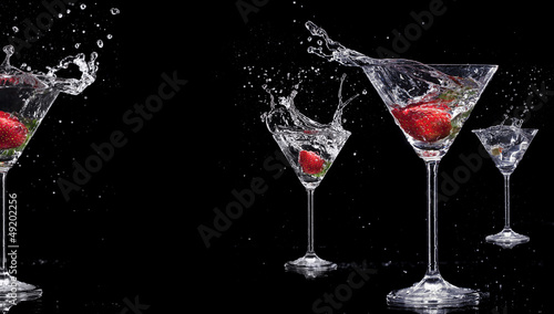 Martini drinks with splashes, isolated on black background - 49202256