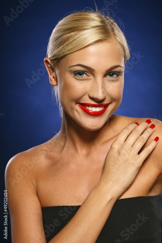 Closeup of young beautiful blond female smiling