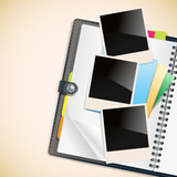 photo frames and notepad sheets on open diary