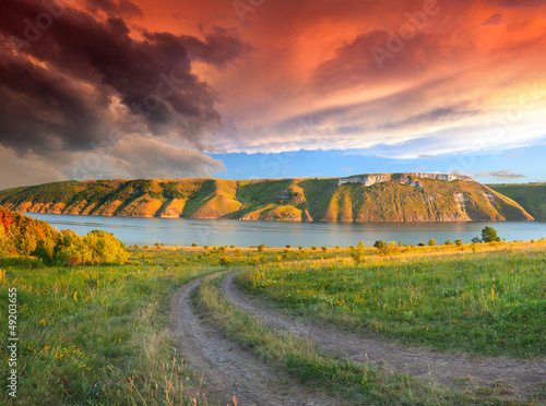 Dramatic summer landscape with the river in the mountains. Sunse