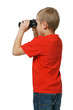 Back view of six years boy looking away through binoculars