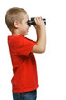 Side view of six years boy looking away through binoculars