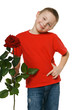 Six years old boy holding the red rose