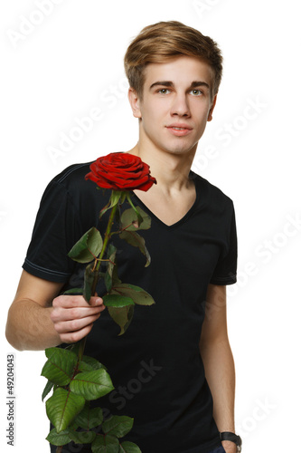 Young hansome man giving you red rose