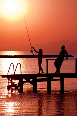 friends are fishing at sunset in turkey
